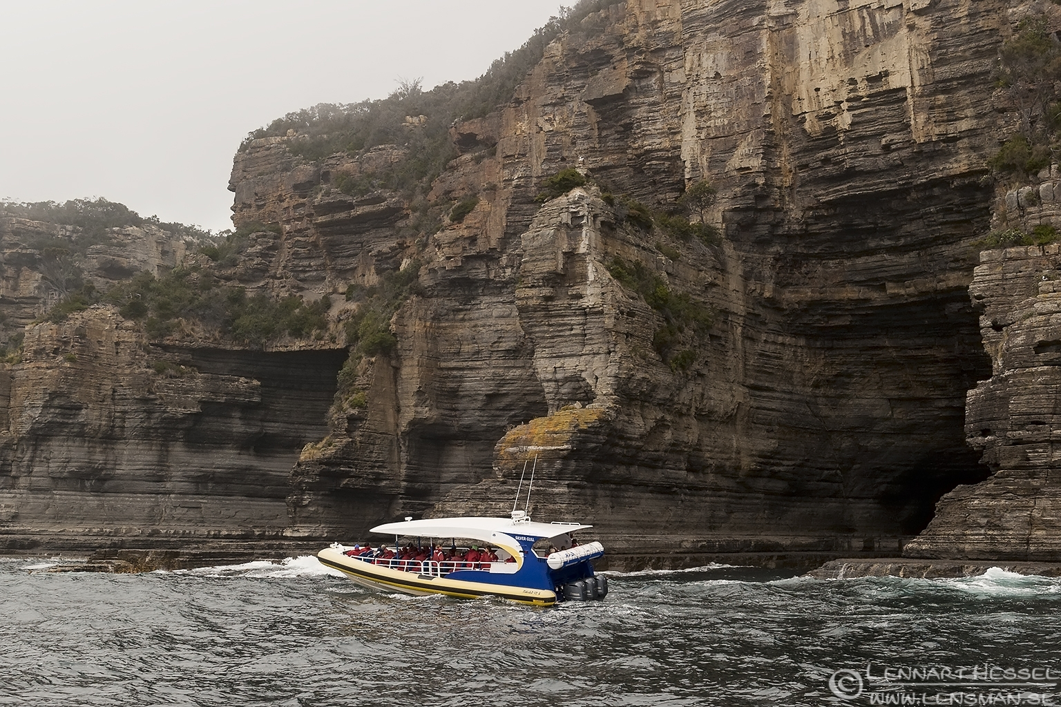 Boat and cliff side Tasmania