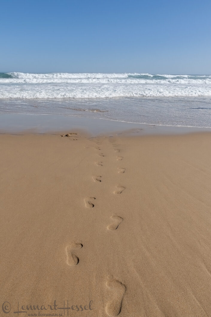 Footsteps in the sand in Brenton on Sea, South Africa